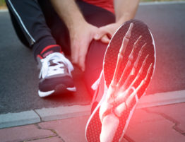 Foot Pain: Man runner outside with digital composite of foot bones