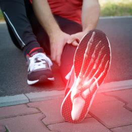 Foot Pain: Man runner outside with digital composite of foot bones